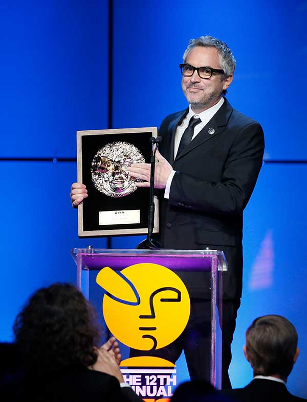 """Gravity"" director Alfonso Cuaron accepts the Visionary Award during the 12th annual VES Awards"