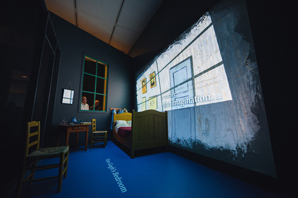 Viewers look into Van Gogh's bedroom to watch Bluecadet's animations projected on the walls.