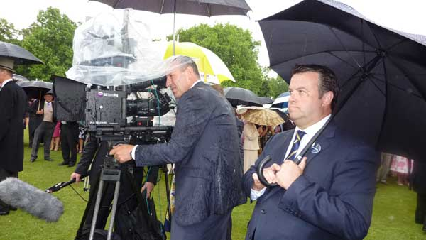 Can Communicate's Duncan Humphreys getting wet at Buckingham Palace shooting 'The Queen in 3D'.